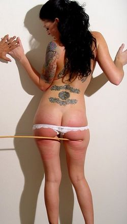 naughty student is tawsed, caned, and spanked until she has bright red ass