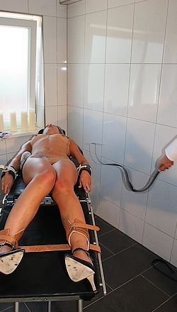 woman tied down with medical style humane restraints for a long and vicious punishment whipping