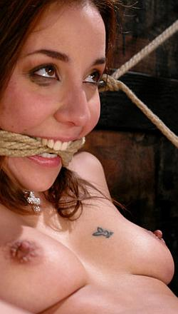 Delilah Strong gives us a pretty and enthusiastic bondage smile